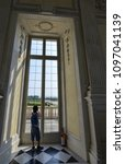 Small photo of Venaria Reale, Piedmont region, Italy. June 2017. A look out on the majestic gardens of the palace. From the inside of the Grand Gallery or Diana through the windows, the landscape is splendid.