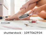 woman having pedicure to her... | Shutterstock . vector #1097062934