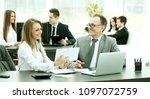 employees using digital tablet... | Shutterstock . vector #1097072759