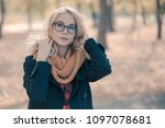 a young woman in big black... | Shutterstock . vector #1097078681