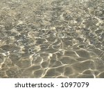 This is a clear neutral colored water background. - stock photo