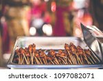 sate ayam or chicken satay ... | Shutterstock . vector #1097082071