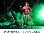 young woman in the gym with a... | Shutterstock . vector #1097125331