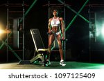 young woman in the gym with a... | Shutterstock . vector #1097125409