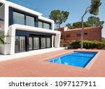 luxurious villa with swimming... | Shutterstock . vector #1097127911