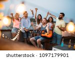 group of happy friends having... | Shutterstock . vector #1097179901