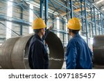 skilled worker pointing up... | Shutterstock . vector #1097185457