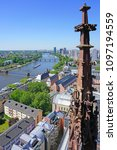 Small photo of FRANKFURT AM MAIN, GERMANY -9 MAY 2018- Aerial panoramic landscape view of the city of Frankfurt taken from the top of the tower of the Frankfurter Dom St. Bartholomew Cathedral.
