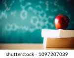 apple puts on a book studying... | Shutterstock . vector #1097207039