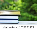 closed books with golden pages... | Shutterstock . vector #1097221979