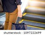 male hand holding blue shopping ... | Shutterstock . vector #1097222699