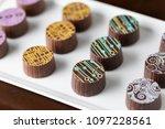 artisan fine chocolate candy on ... | Shutterstock . vector #1097228561