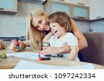 mother and son draw at a table... | Shutterstock . vector #1097242334