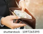 businessman person holding an... | Shutterstock . vector #1097265395