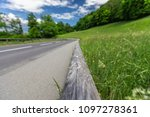 the road is in the mountains in ... | Shutterstock . vector #1097278361