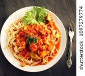 ribbon pasta with arrabiata... | Shutterstock . vector #1097279774
