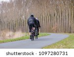 two recreational bikers | Shutterstock . vector #1097280731