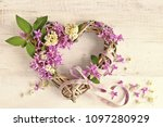 lilac flowers in wicker heart... | Shutterstock . vector #1097280929