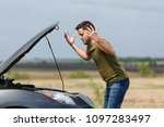 photo of frustrated man next to ... | Shutterstock . vector #1097283497