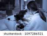 Small photo of Asian scientist working in the lab,Thailand people,Experiment science and calculate the value,Researchers are research to find the results of the experiment.