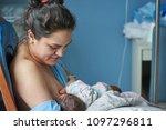 latina mom breast feeding... | Shutterstock . vector #1097296811