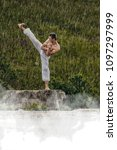 Small photo of man in white kimono during training karate kata exercises in summer outdoors