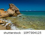 rocky coast. beach in greece.... | Shutterstock . vector #1097304125