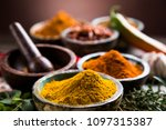 wooden table of colorful spices | Shutterstock . vector #1097315387