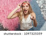 happiness blonde girl in red... | Shutterstock . vector #1097325359
