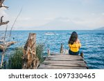woman with yellow blouse... | Shutterstock . vector #1097330465