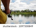 a man with a fishing rod on the ... | Shutterstock . vector #1097330849