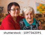 elderly woman with her adult... | Shutterstock . vector #1097362091