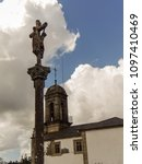 Small photo of the church of San Salvador and the cruceiro that presides over its lateral and its access