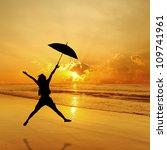 Happy Umbrella Woman Jumping In ...