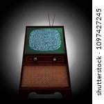 Small photo of An antique television with rabbit ears and static on the screen.