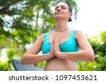 a pregnant woman is meditating... | Shutterstock . vector #1097453621