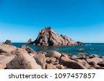 man fishing near sugarloaf rock | Shutterstock . vector #1097457857