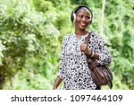 cheerful woman listens to music ...   Shutterstock . vector #1097464109