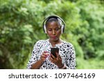 cheerful woman listens to music ...   Shutterstock . vector #1097464169
