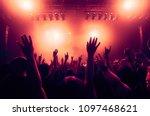 concert crowd at rock concert | Shutterstock . vector #1097468621
