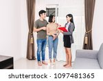 real estate agent holding... | Shutterstock . vector #1097481365