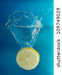 Lemon splashing into cold water - stock photo
