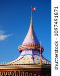 Small photo of A whimsical canopy tops off a carousel in an amusement park