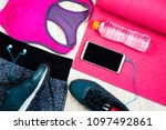 Small photo of Women's Exercise Dress Red shirt and black pants Use to wear a workout. Drinking water, headphones and Clock uses timer Placed on a white background.