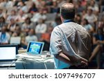 speaker giving a talk on... | Shutterstock . vector #1097496707