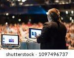 female speaker giving a talk on ... | Shutterstock . vector #1097496737
