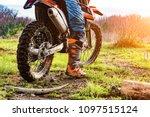 Man Riding A Motocross In A...
