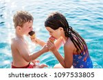 child sharing an ice cream by... | Shutterstock . vector #1097533805