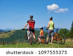 back view of sportsman family...   Shutterstock . vector #1097555375