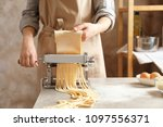 young woman preparing noodles... | Shutterstock . vector #1097556371